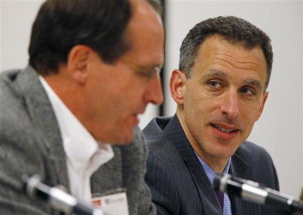 Federal Reserve Governor Jeremy Stein (R) listens as senior policy advisor at the Boston Federal Reserve Bank Jeffrey Fuhrer speaks at a mac