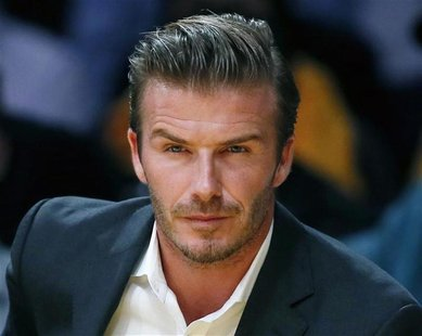 British soccer star David Beckham sits courtside as the Los Angeles Lakers play the Dallas Mavericks during their NBA basketball game in Los