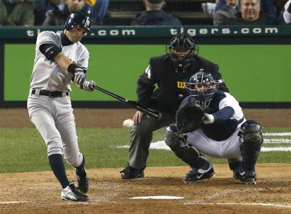 New York Yankees Ichiro Suzuki connects for a single against the Detroit Tigers during the seventh inning during Game 3 in their MLB ALCS ba