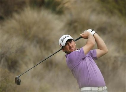 Graeme McDowell of Northern Ireland tees off on the 14th hole during the third round of the World Challenge golf tournament in Thousand Oaks