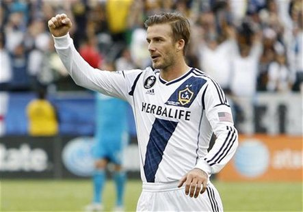 Los Angeles Galaxy's David Beckham celebrates after teammate Omar Gonzalez scored a goal against Houston Dynamo during the second half of th