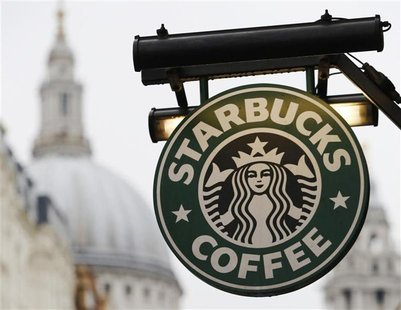 St Paul's Cathedral is pictured behind signage for a Starbucks coffee shop in London October 8, 2012. Picture taken October 8, 2012. REUTERS