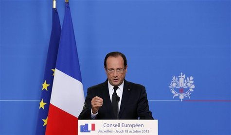 France's President Francois Hollande speaks at a news conference at the end of the first session of a two-day European Union (EU) leaders su