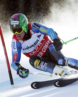 Ted Ligety of the U.S. skis to first place in the first run of the men's World Cup giant slalom ski race in Beaver Creek, Colorado December
