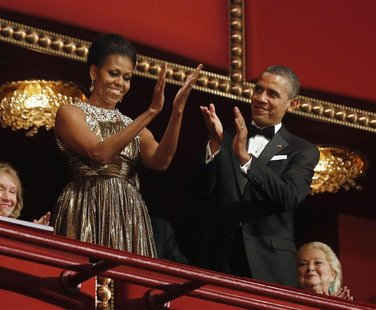 U.S. President Barack Obama (R) and first lady Michelle Obama applaud on the balcony as they attend the 2012 Kennedy Center Honors at the Ke
