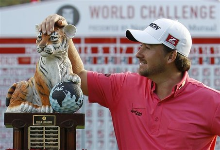 Graeme McDowell of Northern Ireland poses with his trophy after winning the World Challenge golf tournament in Thousand Oaks, California, De