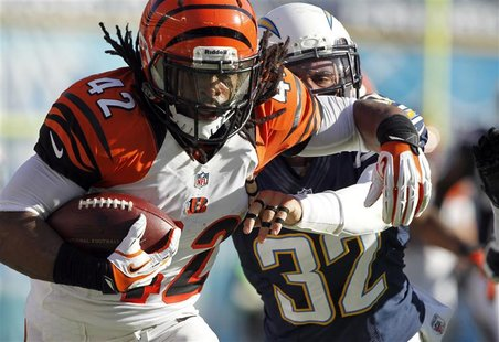 Cincinnati Bengals running back BenJarvus Green-Ellis (42) is pushed out-of-bounds by San Diego Chargers free safety Eric Weddle (32) after