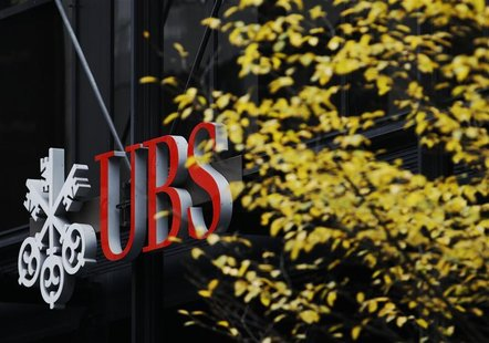 Signs are seen on the outside of Swiss bank UBS in central London November 20, 2012. REUTERS/Luke MacGregor