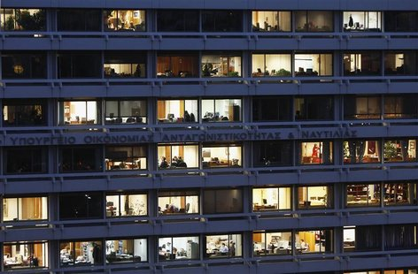 Employees are seen working in their offices in the building housing Greece's finance and development ministries in Athens November 29, 2012.