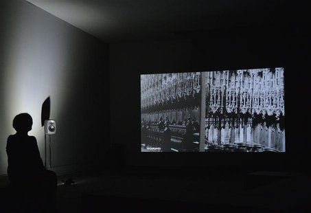 A visitor watches 'THE WOOLWORTHS CHOIR OF 1979', a video installation by Elizabeth Price, at Tate Britain in London October 1, 2012. REUTER