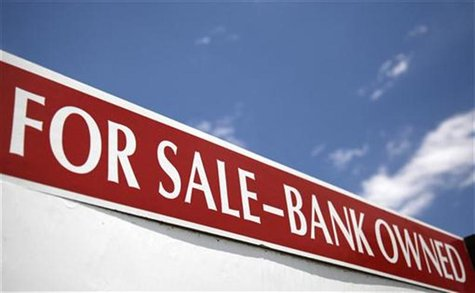 A bank-owned property for sale sign in Arvada, Colorado June 23, 2009. REUTERS/Rick Wilking