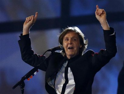Former Beatle Paul McCartney sings during the opening ceremony of the London 2012 Olympic Games at the Olympic Stadium July 27, 2012. REUTER