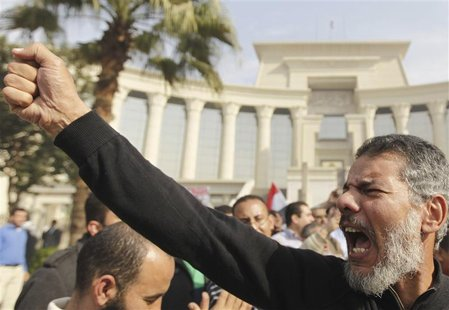 A supporter of Egypt's President Mohamed Mursi gestures during a rally in front of the Supreme Constitutional Court in Maadi, south of Cairo