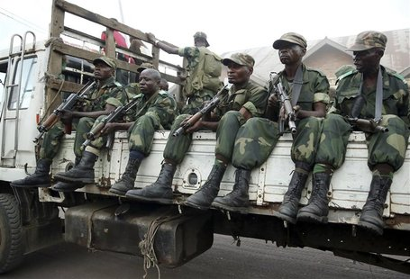 Government army FARDC soldiers drive in trucks as they arrive in Goma December 3, 2012. REUTERS/Goran Tomasevic