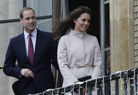 Britain's Prince William (L) and Catherine, Duchess of Cambridge wave while visiting the Guildhall in Cambridge, central England November 28
