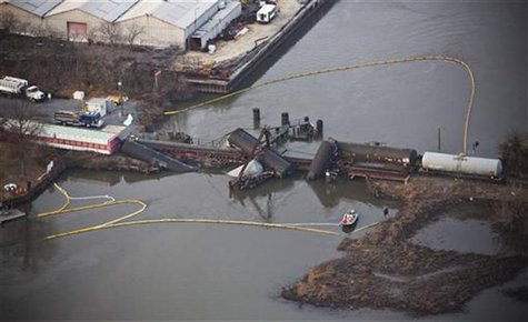 Derailed freight train cars sit semi-submerged in the waters of Mantua Creek after a train crash in Paulsboro, New Jersey November 30, 2012.