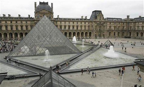 General view of the Louvre Museum with its glass Pyramid entrance designed by Chinese-born U.S. Architect I.M. Pei, in Paris, August 6, 2007