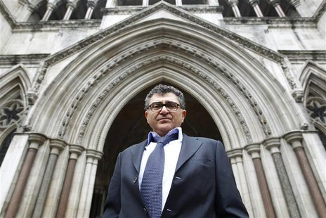 Property magnate Vincent Tchenguiz poses for a photograph as he arrives at the High Court in London March 16, 2011. REUTERS/Andrew Winning