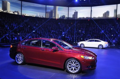 A pair of 2013 Ford Fusions make their debuts on the first press preview day for the North American International Auto Show in Detroit, Mich