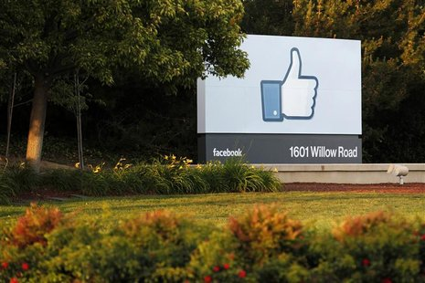 The sun sets on the entrance sign at Facebook's headquarters in Menlo Park, California, the night before the company's IPO launch, May 17, 2