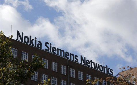 The logo of the telecommunications services company Nokia Siemens Networks is pictured on top their office in Berlin October 9, 2012. REUTER