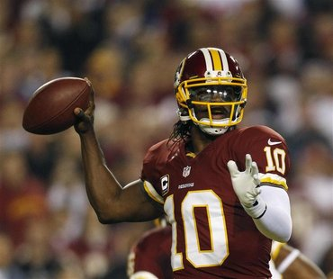 Washington Redskins quarterback Robert Griffin III throws against the New York Giants defense during the first half of their NFL football ga