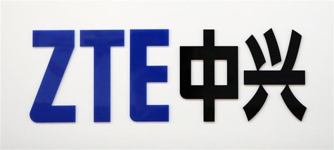 A ZTE company logo is seen at the company's exhibition pavilion during the CommunicAsia information and communications technology trade show
