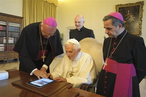 Pope Benedict XVI uses an iPad device at the Vatican in this file photo dated June 28, 2011. Pope Benedict's handle on Twitter will be @pont