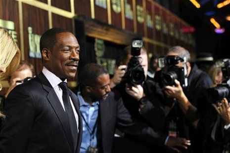 "Actor Eddie Murphy (L) poses as he arrives for the taping of the Spike TV special tribute ""Eddie Murphy: One Night Only"" at the Saban theatr"