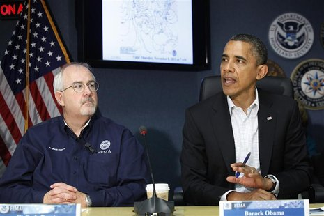 U.S. President Barack Obama (R), sitting with Federal Emergency Management Agency (FEMA) administrator William Craig Fugate (L), talks to re
