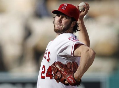 Los Angeles Angels starting pitcher Dan Haren delivers against the Texas Rangers during the first inning of an MLB baseball game in Anaheim,