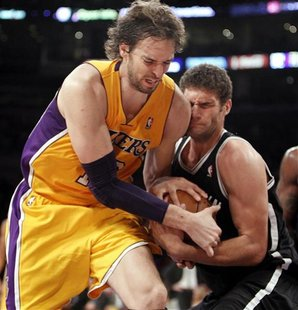 Los Angeles Lakers' Pau Gasol (L) of Spain fights for the ball with Brooklyn Nets' Brook Lopez during the second half of their NBA basketbal