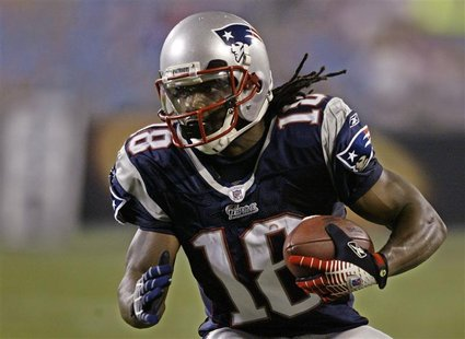 New England Patriots' wide receiver Donte Stallworth advances with the ball during second half pre-season NFL action in Charlotte, North Car