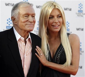 Hugh Hefner and his fiancee, Playboy Playmate Crystal Harris, arrive at the opening night gala of the 2011 TCM Classic Film Festival featuri