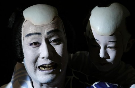 Japanese Kabuki actor Nakamura Kanzaburo (L) of the Tokyo's Heise Nakamura-za theatre performs during a dress rehearsal for the 'Summer Fest