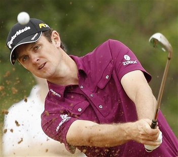 Justin Rose of England hits out of a bunker on the 14th hole during the Nedbank Golf Challenge in Sun City, December 1 2012. REUTERS/Siphiwe