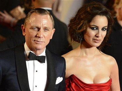 "Actor Daniel Craig and actress Berenice Marlohe pose for photographers as they arrive for the royal world premiere of the new 007 film ""Skyf"