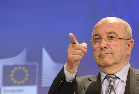European Union Competition Commissioner Joaquin Almunia gestures during a news conference at the EU Commission headquarters in Brussels Dece
