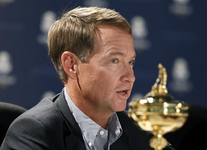 U.S. captain Davis Love III attends a news conference after arriving for the 39th Ryder Cup golf matches at the Medinah Country Club in Medi