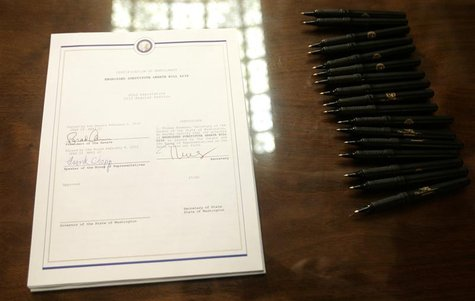 The Washington state bill legalizing gay marriage in the state lies on a table before it is signed by Governor Christine Gregoire, in Olympi