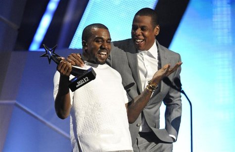 Kanye West and Jay-Z (R) accept the award for best group at the 2012 BET Awards in Los Angeles, July 1, 2012. REUTERS/Phil McCarten
