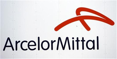 A logo of ArcelorMittal steel group is seen at the Les Chantiers de l'Atlantique shipyards in Saint Nazaire, western France, July 9, 2009. R