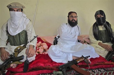 Wali-ur-Rehman (C), deputy Pakistani Taliban leader, who is flanked by militants speaks to a group of reporters in Shawal town, that lies be