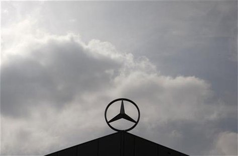 A Mercedes Benz logo is silhouetted against the sky at a newly completed factory of German car maker Daimler in Kecskemet, 90km (56 miles) e