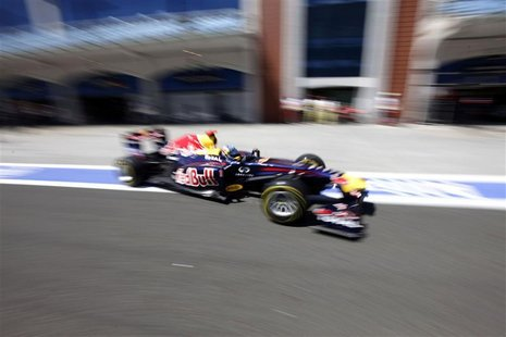 Red Bull Formula One driver Sebastian Vettel of Germany drives after a pit stop in the qualifying session of the Turkish F1 Grand Prix at th