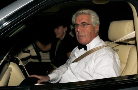 Publicist Max Clifford arrives for music and television mogul Simon Cowell's 50th birthday party celebration at Wrotham Park in Barnet, nort