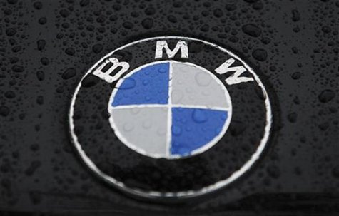 A logo of BMW is pictured on a car before the German luxury carmaker BMW annual shareholders meeting at the company's headquarters in Munich