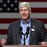 Michigan Republican Governor Rick Snyder introduces Mitt Romney, U.S. Republican presidential candidate and former Massachusetts governor, d