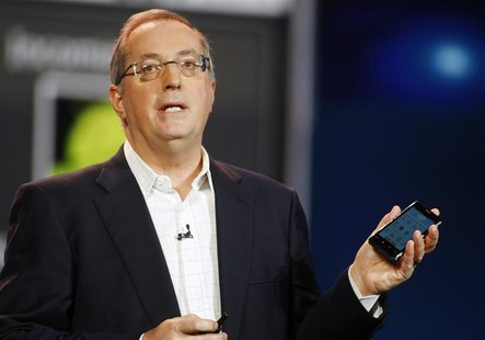 Paul Otellini, president and CEO of Intel Corporation, holds an Intel smartphone reference design as he gives a keynote address during the 2