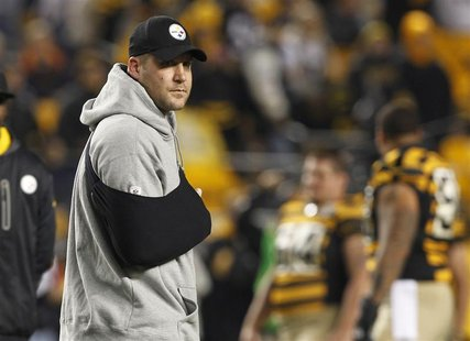 Injured Pittsburgh Steelers quarterback Ben Roethlisberger stands on the field with his arm in a sling before the start of their NFL footbal